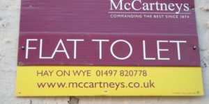 (BrE) flat to let