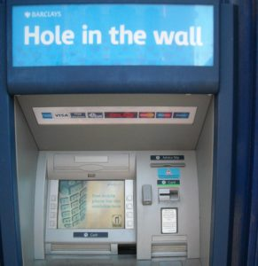 (BrE) hole-in-the-wall